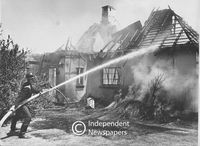 Fireman puts out a fire which engulfed a house, Cape Town