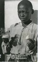 Boy with government school-feeding ration, Cape Town