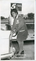Black woman petrol attendant, Parow, Cape Town