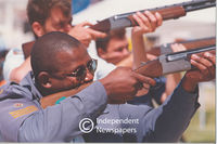 Policemen aiming their guns to fire, Cape Town
