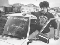 Man inspects his shattered windscreen, Cape Town