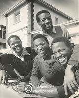 Four men smile for the camera, Cape Town