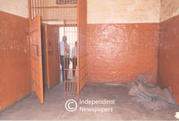 Prison warden shows the inside of a prison cell, Cape Town