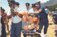 Policemen carry away protester, Cape Town