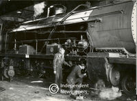 Men working on the engine of a train, Cape Town