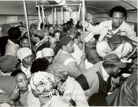 A train carriage full to capacity with commuters, Cape Town