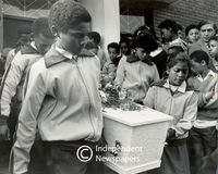 Pupils carry the coffin of their friend, Cape Town