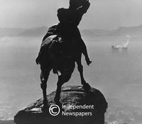 Silhouette of a statue looking over the city, Cape Town