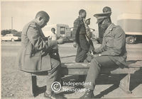 Two policemen take a break and play cards, Cape Town