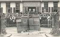 Pupils tie a placard to the gate of their school, Cape Town