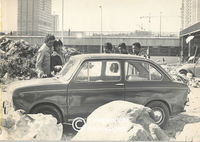 Youths inspect the damage done to their car by rioters, Cape Town
