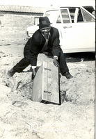 Man pulls out trunk from the ground, Cape Town