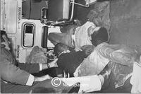 Two injured protesters lie in an ambulance, Cape Town