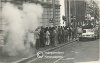 Protesters flee from a smoke canister, Cape Town