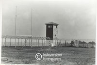 Prison watch tower overlooking field , Robben Island, Cape Town