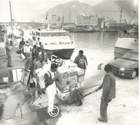 Freed prisoners disembark from the boat, Cape Town