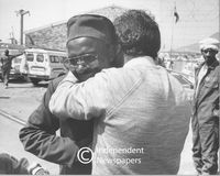 Freed prisoner receiving hug, Cape Town