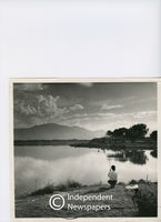 Boy fishes in vlei, Cape Town