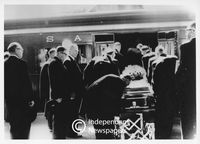 South African Prime Minister Strijdom's coffin being loaded onto a train, 1958