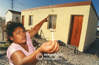 Nails holding Delft houses roofs in place, Cape Town