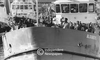Freed men respond to ANC slogans when the ferry arrived at the harbour, Cape Town