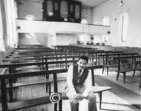 Rev. Karl August inside his church in District Six, Cape Town