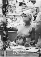 Domestic worker shopping with child, Cape Town