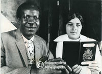 Mr Boyied Chinyama and his wife show his Malawi passport, Cape Town