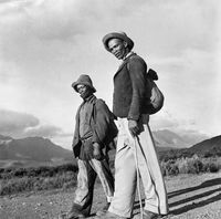 Two men walking with backpacks, Genadendal, South Africa