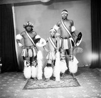 Studio portrait of Zulu men and a boy