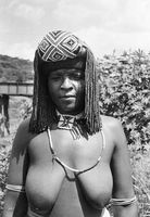 Zulu woman wearing braids and headdress