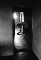 Girl cleaning rural home, Goedgevonden, South Africa