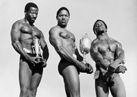Weight lifters holding trophies. 2 Boy Ndabandune on right, Eastern Cape, South Africa