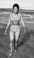 Woman walking out of sea in bikini, Eastern Beach, Eastern Cape, South Africa