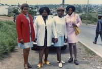 Group of women posing on pavement, Eastern Cape, South Africa