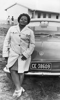 Woman leaning against bonnet of car, Eastern Cape, South Africa