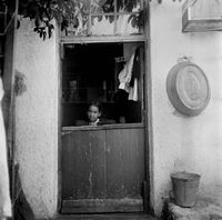Young girl standing in a doorway, District Six, Cape Town, South Africa