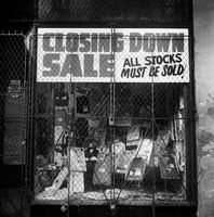 Closing down sign in store window, District Six, Cape Town, South Africa