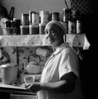 Woman holding tea in a kitchen, District Six, Cape Town, South Africa