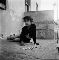 Young girl playing with stones, District Six, Cape Town, South Africa