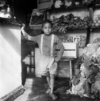 Young boy in a food store, District Six, Cape Town, South Africa