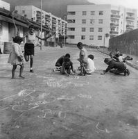 Children playing on the road near their homes in District Six, Cape Town, South Africa