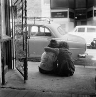 Two young girls hugging, District Six, Cape Town, South Africa