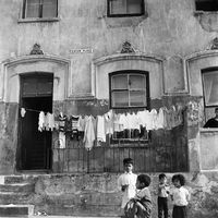 Young children in front of their apartment block, District Six, Cape Town, South Africa