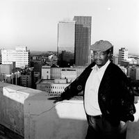 Mr. Nycobo standing on the roof of a building, Johannesburg, South Africa