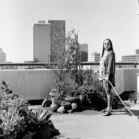 Simonetta Gatto watering her plants, Ansleys Building, Johannesburg, South Africa