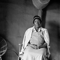 Elderly woman in the Mai Mai hostel, Johannesburg, South Africa