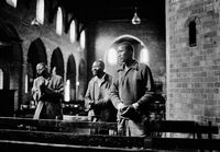 Three men praying in a church, South Africa