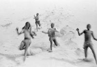 Children running down a sand dune, Transkei, South Africa