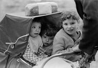 Three children being pushed in a pram, South Africa